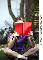 A child reading a book - outdoor