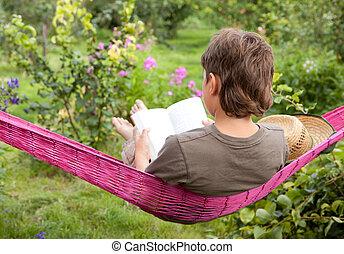 A child resting in hammock