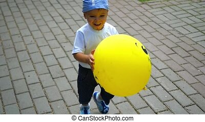 a child running in the Park with balloon