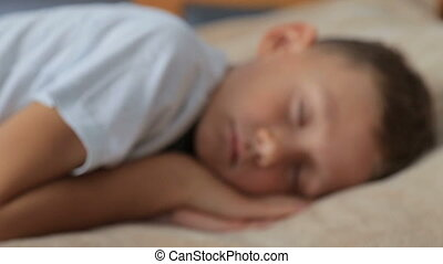 A child sleeps in bed,full hd video - The boy is sleeping on...