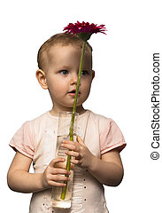 A child with a vase and a flower - The little girl on a...