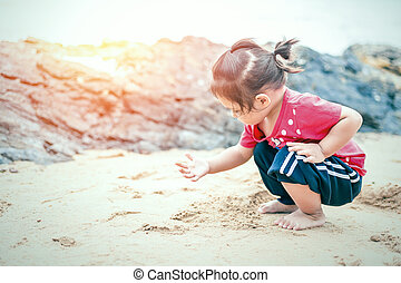 A children play toy with sand on the beach.
