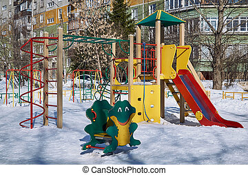 A children's Playground with a slide, a ladder, swings, a rope and a frog rocking chair.