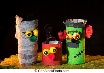 A child's handicraft figurines made of toilet paper rolls ...