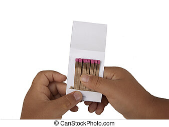 A child's hands holding a booklet of matches
