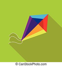 A child's toy a kite on a bright green background
