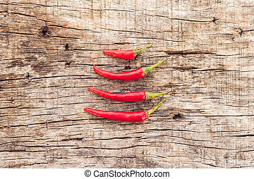 a Chilli pepper on old wooden surface