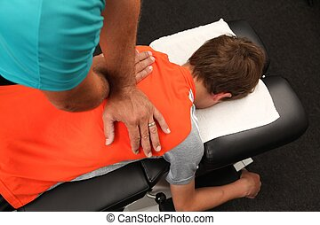 Chiropractor - A Chiropractor treating a child