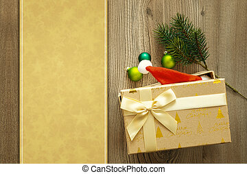 christmas decoration background with a gift on wooden background
