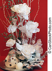 Christmas floral display - A Christmas floral display with a...