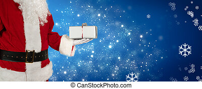 Christmas greeting card with Santa Claus holding a gift in his hand