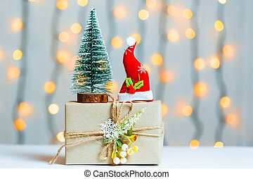 A Christmas tree with gift box on blurred bokeh banner...