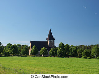 A church building in the field