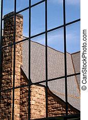 Church reflection in a glass window