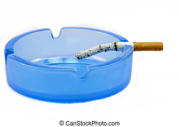ashtray - a cigarette is consumed in an ashtray