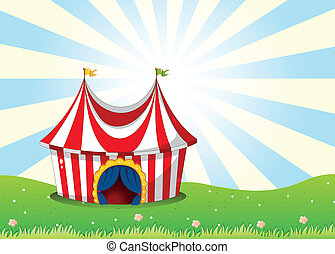 A circus tent at the top of the hill