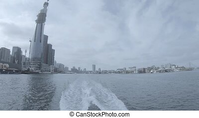 A cityscape at Sydney Harbour tracking shot daytime