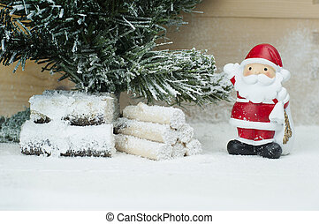 A clay figurine of Santa Claus and Christmas tree.