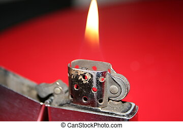 A Close Detail Of Zippo Lighter With Flame