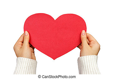 A close up of a female hand holding a red paper heart with copy space. Love and romance concept. Isolated on a white background