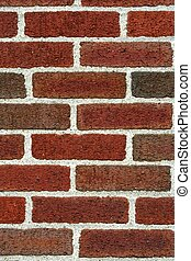 Red Brick Wall - A Close-up of a Red Brick Wall is...