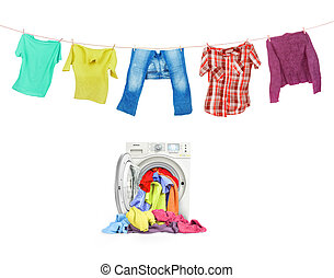 A close up of a washing machine loaded with clothes and clothes on the ropes isolated on white background