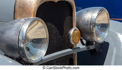 close up of antique car headlamps.
