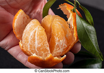 close up of hands with a clementine