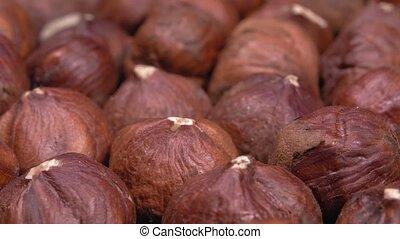 A close-up of hazelnuts. Whole nut kernels. Lots of fruit. Hazelnut macro.