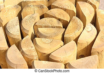 split wooden posts - A close up of many split wooden posts