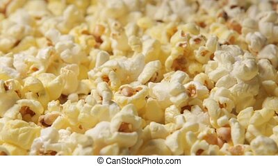 a close-up of newly cooked popcorn rotating in a popcorn...