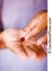 taking medicine - a close up of on medicine on palm, woman...