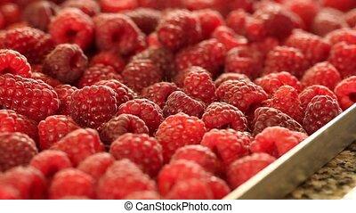 raspberries pan left - a close up of raspberries pan left