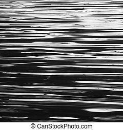 ripples - A close up of the beautifully lit ripples