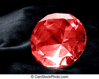Ruby - A close up on a Ruby jewel on a dark background. ...
