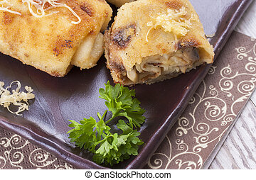 Croquette - A close up photo of a fried Croquettes stuffed ...