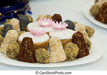 A close up picture of a plate with sweets