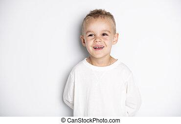 Close up portrait of cute little boy on background