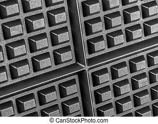 A close up shot of a waffle iron