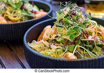 close up view of delicious and healthy summer greens salad with shrimp