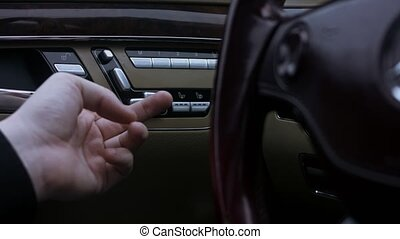 A close up view of electric seat adjustment with controlling buttons, inside a car. Interior door seat adjust button switch. 4K video