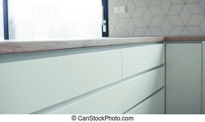 A close-up view of modern kitchen cupboards in house or flat...