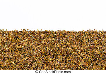 A close-up view of Rooibos tea area isolated on white background with place for text