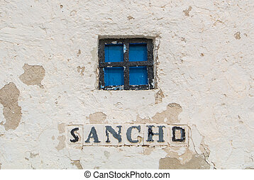 A close-up view to a window of an old windmill on the hill...