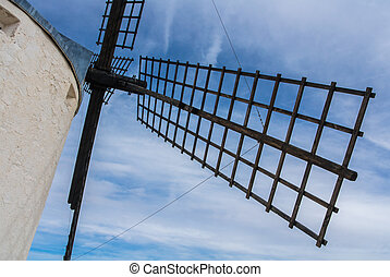 A close-up view to an old windmill on the hill near...
