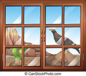 A closed window with a view of the bird at the desert