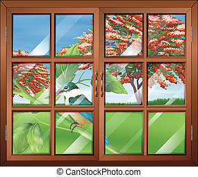 A closed window with a view of the bird outside