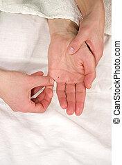 hand reflex zone massage - a closeup of a hand of a natural ...