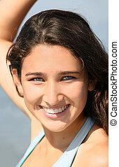 smiling teenage girl - A Closeup of a smiling teenage girl