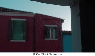 A closeup of a spiderweb on a stone opening in front of a...